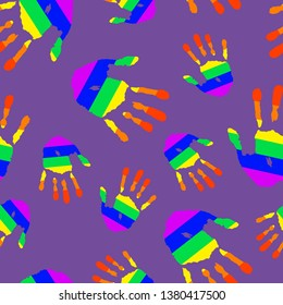 Seamless pattern palms with rainbow colors of LGBT flag on purple background. Colorful handprint. Concept Pride day, tolerance, equality, freedom, rights community lesbian and gay.