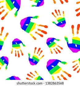 Seamless pattern. Rainbow palms of LGBT flag on white background. Handprint texture for design card of Pride day, tolerance, equality, freedom, rights community lesbian and gay.