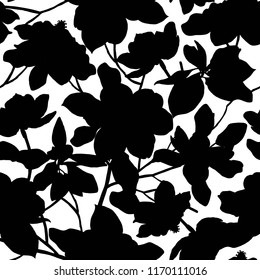 Seamless pattern with silhouettes of magnolia flowers and leaves on black background. Floral illustration. Beautiful plants for cards, prints, textile