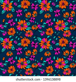 Seamless pattern . Smal field flowers.  Orange, pink, dark blue. Dark background.Ditsy print. Seamless vector texture. Elegant template for fashion prints. For textile, wallpaper.
