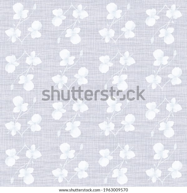 Seamless pattern small  light white flowers and branches on the  linen blue background. Watercolor
