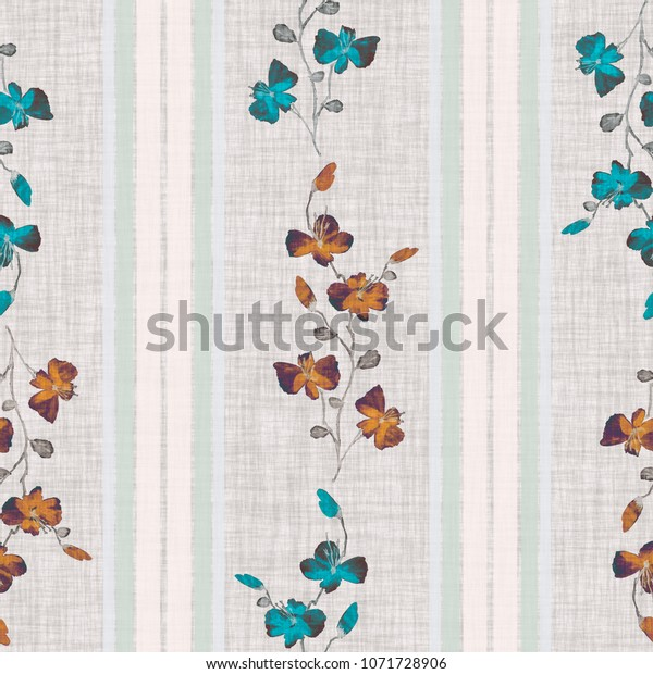 Seamless pattern small wild blue and orange branchs of flowers on a gray linen background with vertical strips. Watercolor