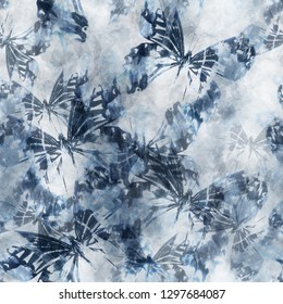 Seamless pattern tie-dye design. Indigo background with butterflies and watercolor effect. Textile shibori print for bed linen, jacket, package design, fabric and fashion concepts.