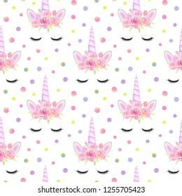 Seamless pattern with unicorn faces and watercolor circles on a white background. Perfect for children's textile and postcards.