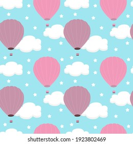Seamless pattern with white clouds and pink balloons on a blue sky background. For printing on fabrics, textiles, paper, bedding.