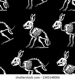 Seamless pattern. White skeletons of rabbits on a black background. Anatomy of a hare. Great for printing on T-shirts, for tattoos and more. Ideal for decoration of Halloween and the Day of the Dead.