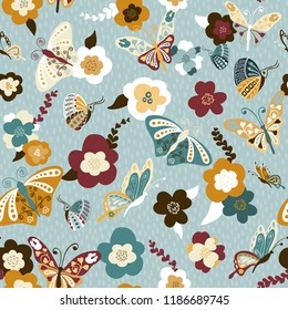 Seamless repeating pattern of pretty butterflies and flowers