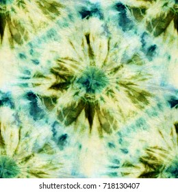 Seamless tie-dye pattern of green color on white silk. Hand painting fabrics - nodular batik. Shibori dyeing.