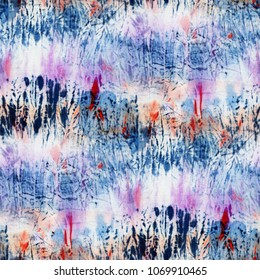 Seamless tie-dye pattern of indigo and pink color on white silk. Hand painting fabrics - nodular batik. Shibori dyeing.