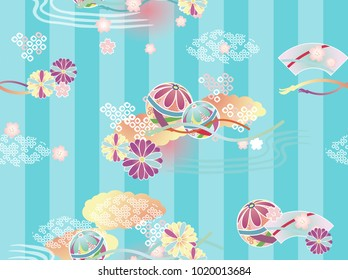 Seamless tradtional japanese kimono pattern. For children and girls. Balls,  chrysanthemum and ougi on blue vertical stripes background.
