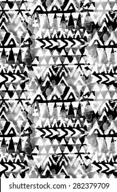 seamless tribal pattern with geometric motifs and splashes of color. ethnic design, ornamental details. black and white, monochrome palette. for fashion or interior