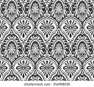 Seamless wallpaper design. Symmetric monochrome black &awhile paisleys with ornamental decorative elements. Pattern for fashion or interior.