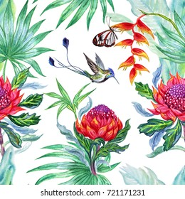 Seamless watercolor pattern of tropical flowers , palm leaves, butterflies and hummingbirds on a white background.