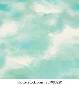 Seamless watercolor wash pattern on paper texture. Abstract background
