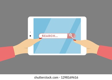 Searching on tablet. Hands holding device and surfing the net.
