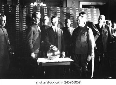 Secretary of War Newton D. Baker, wearing a blindfold, initiates the second draft of WWI. He draws the first number, 246, out of a glass bowl to start the draft. June 1918.