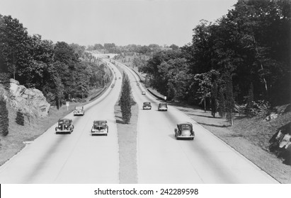 Section of the Merritt Parkway in Connecticut, one of the first four lane limited access highways in the United States, opened on June 29, 1938.