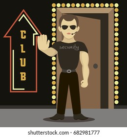 Security man standing near night club.