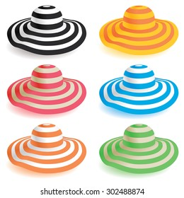 A selection of floppy beach hats in various colors.