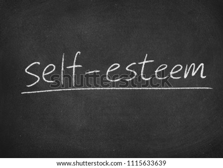 self esteem concept word on a blackboard background