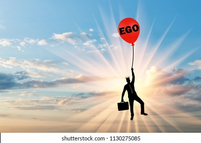 Selfish businessman holding on to a balloon called the ego. Conceptual scene of a narcissistic and selfish businessman