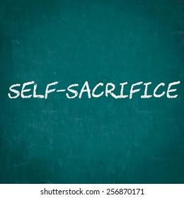 SELF-SACRIFICE written on chalkboard