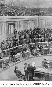 "In the Senate, March 25, 1898--Reading the President's message on the destruction of the ""Maine"". Washington, D.C. ca. 1900"