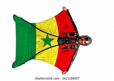 Senegal airport. Bird men in wing suit flag. Sky diving men in parashute. Patriotism, men and flag Senegal.