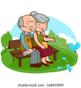 Senior couple sitting on a bench at the park.