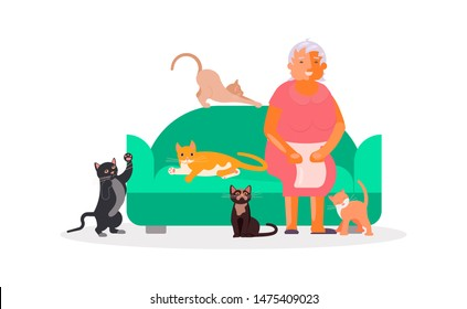 Senior woman with a lot of cats sitting on sofa. Happy old lady pets owner.