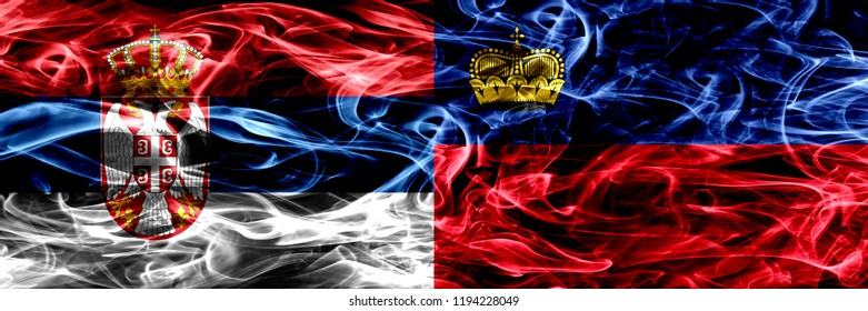 Serbia vs Liechtenstein, Liechtensteins smoke flags placed side by side. Thick colored silky smoke flags of Serbian and Liechtenstein, Liechtensteins