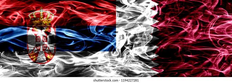 Serbia vs Qatar, Qatari smoke flags placed side by side. Thick colored silky smoke flags of Serbian and Qatar, Qatari