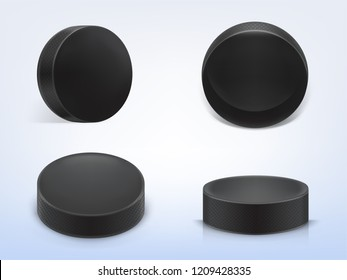 set of 3d realistic black rubber pucks for play ice hockey isolated on light background. Sport equipment, hard round disk, inventory for winter team game on skating rink