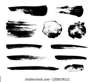 Set of black grunge brushes as paint strokes for textures overlay. Artistic ink blots isolated on white background
