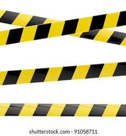 Set of black and yellow glossy barrier tapes  isolated on white
