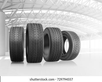 Set of four car tires at big warehouse. 3d illustration.