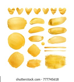 Set of gold shining brush strokes and hearts for you amazing design project. Watercolor texture paint stain isolated on white. Abstract hand painted golden background.
