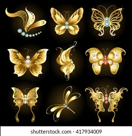 Set of golden dragonflies and butterflies, encrusted with sapphires, rubies and diamonds on black background.