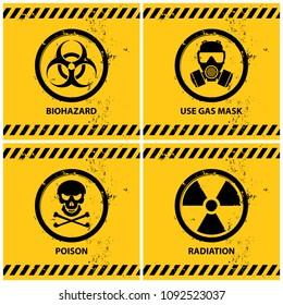 set of grunge danger banners containing four official international hazard symbols