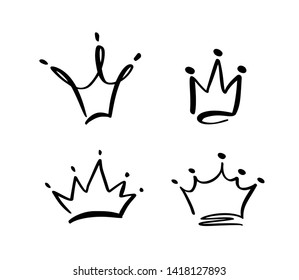 Set of hand drawn symbol of a stylized crown. Drawn with a black ink and brush. illustration isolated on white. Logo design. Grunge brush stroke