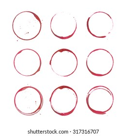 Set of isolated wine stain circles. Red wine stains and spots. Wine bottom glass ring stains for badge design. Red watercolor hand drawn glass marks of wine stain on white.
