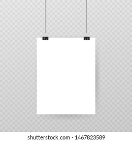 Set of multicolored binder clips on a piece of paper on a background. Clerical clothespin on a background