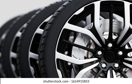 Set of wheels with modern alu rims close-up on white background - banner composition. 3D illustration