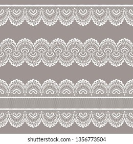 Set of white lace borders on a beige background