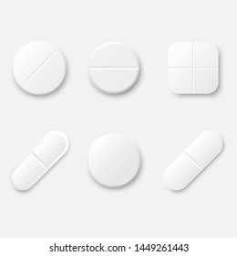 Set of white realistic medical pills. Round and oval tablets, painkillers, antibiotics, vitamins and aspirin. Medicine and drugs. Template design for medical and healthcare concept.