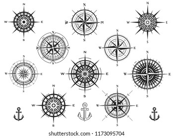 Set of wind roses silhouettes on white background. Compass raster illustrations.