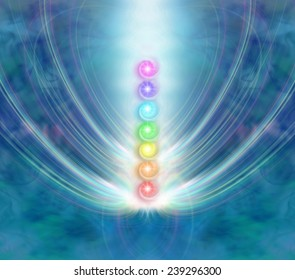 The Seven Chakras - Ethereal blue energy formation background with a central column of the seven chakras in a beam of spiraling light