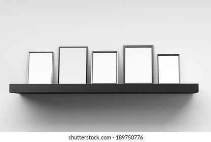 several blank frames from front leaned against a wall