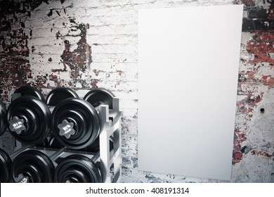 Several dumbbells and a blank poster on aged brick wall background. Mock up, 3D Rendering