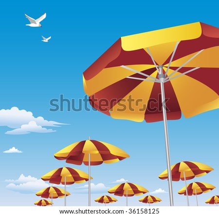 7ff48c1f0 Several rows of brightly colored red and yellow beach umbrellas against  brilliant blue sky with white clouds. Two seagulls are flying high above.